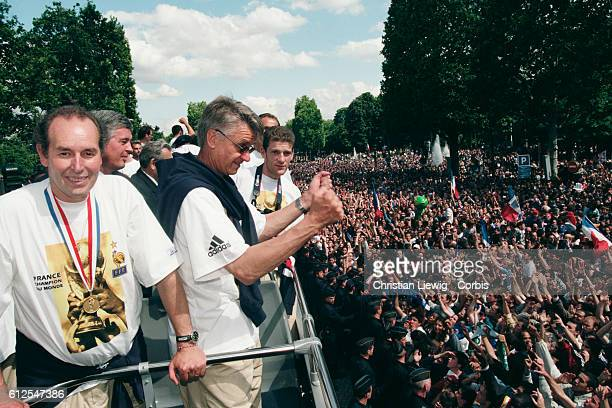 French head coach Aime Jacquet of France's 1998 FIFA World Cup squad during their parade on the Champs Elysees to mark the team's 30 victory over...