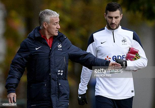 French headcoach Didier Deschamps speaks with French forward Andre Pierre Gignac before a training session on November 11 as they ready for their...