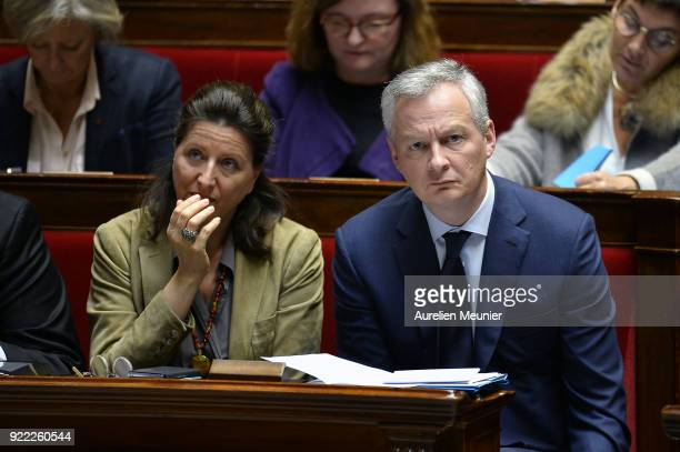 French Health and Solidarity Minister Agnes Buzyn and French Minister of Economics Bruno Le Maire reacts as Ministers answer deputies during a...