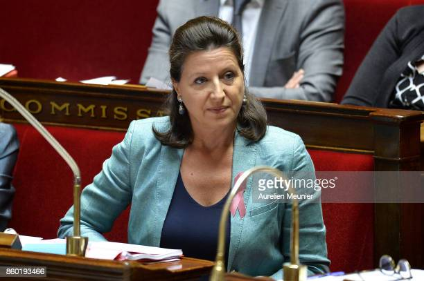 French Health and Solidarity Minister Agnes Buzyn reacts as Ministers answer deputies during the weekly questions to the government at the Assemblee...