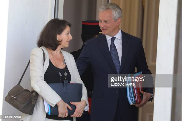French Health and Solidarity Minister Agnes Buzyn speaks with French Economy and Finance Minister Bruno Le Maire as they leave the weekly cabinet...