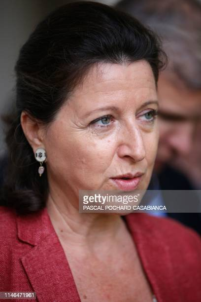 French Health Minister Agnes Buzyn answers journalists after a visit of the construction site of the future hospital of Ajaccio on the French...