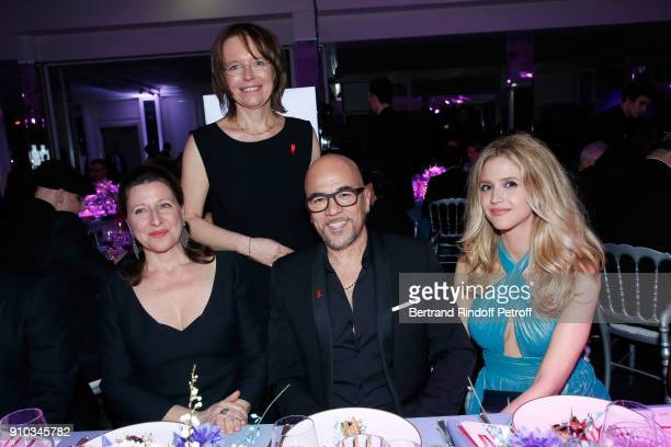 French Health Minister Agnes Buzyn Director of France programs for the association Sidaction Florence Thune Pascal Obispo and his wife Julie Obispo...