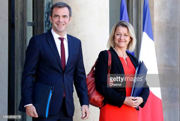 French Health Minister Olivier Veran and Barbara Pompili newly appointed French Minister for the Ecological Transition leave the Elysee presidential...
