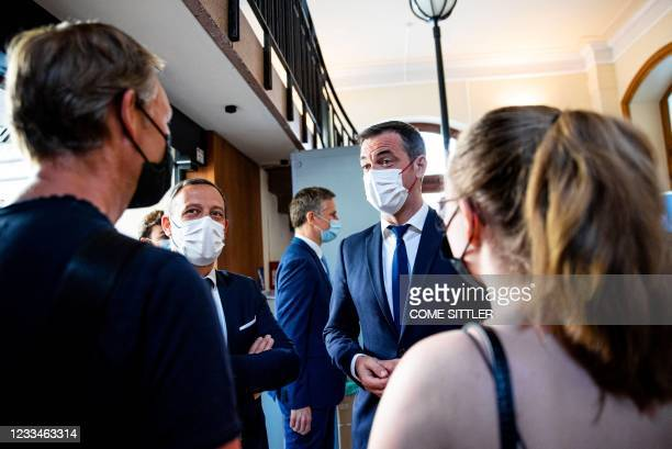 French Health Minister Olivier Veran and French Junior minister for Childhood and Family Affairs Adrien Taquet speak with a young people as they...