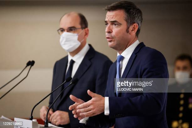 French Health Minister Olivier Veran delivers a speech next to French Prime Minister Jean Castex during a press conference, at the Hotel Matignon, in...