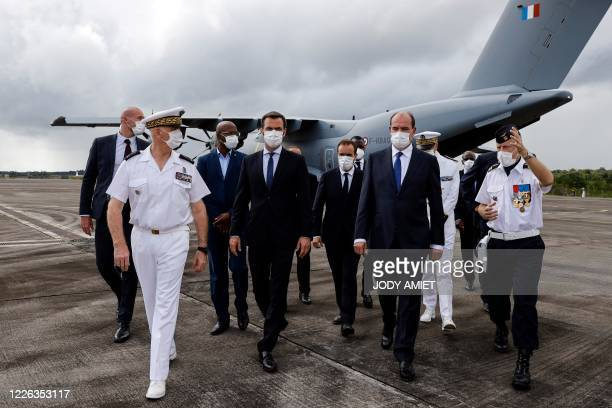 French Health Minister Olivier Veran , French Overseas Minister Sebastien Lecornu and French Prime Minister Jean Castex visit the Matoury Air Base...