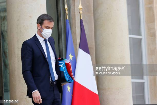 French Health Minister Olivier Veran looks down as he leaves after taking part in the weekly cabinet meeting at The Elysee Presidential Palace in...