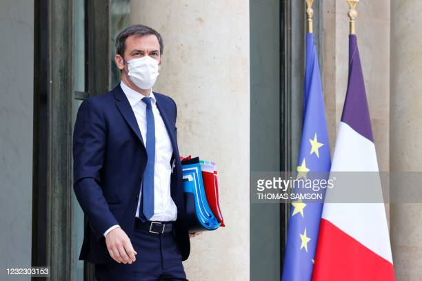 French Health Minister Olivier Veran looks on as he leaves after taking part in the weekly cabinet meeting at The Elysee Presidential Palace in Paris...