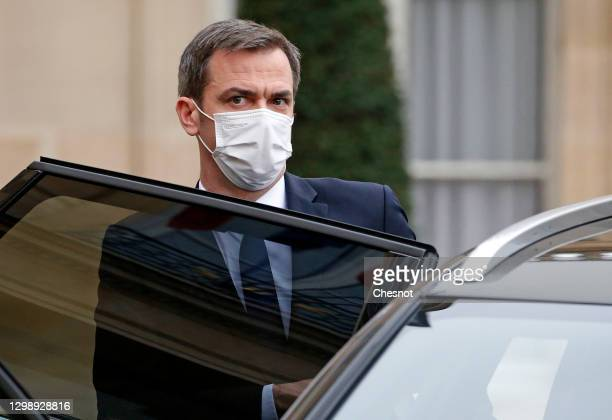 French Health Minister Olivier Veran, wearing a protective face mask, leaves after the weekly cabinet meeting at the Elysee Palace on January 27,...