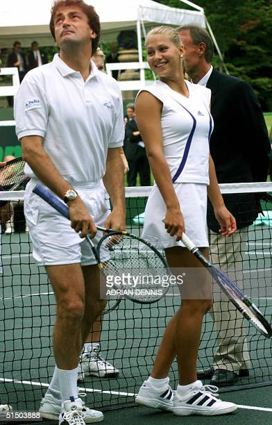 French Henri Leconte jokes around with Russian Anna Kournikova while being introduced at a charity tennis match in the gardens of Buckingham Palace...