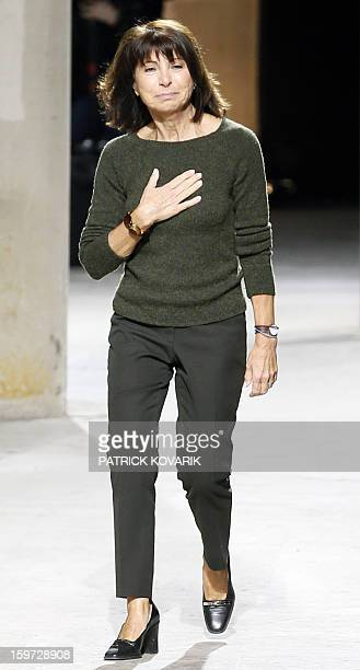 French Hermes designer Veronique Nichanian aknowledges the audience on January 19 2013 at the end of the men's fallwinter 20132014 fashion week in...