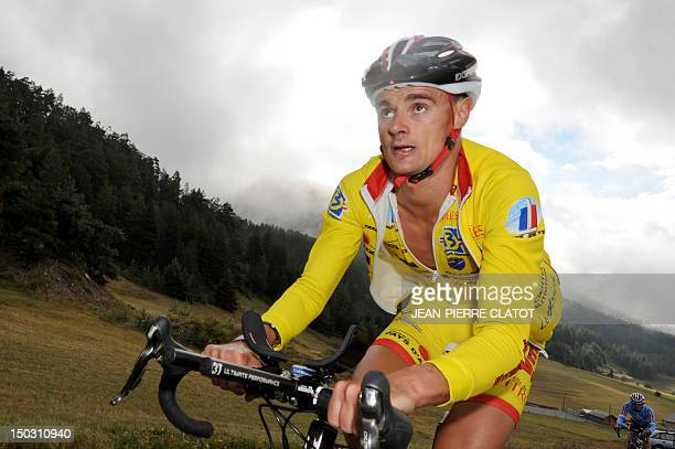 French Herve Faure rides during the 27th edition of the Embrunman triathlon on August 15 2010 near Embrun southeastern France The Embrunman is...