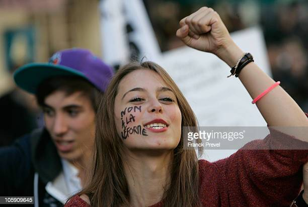 French high school students with the message 'No to the reform' attend a demonstration over pension reform on October 21 2010 in Paris France France...