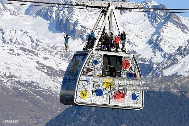 French highliner Tancrede Melet performs on the Paradiski cable way 380m high designed by French creator JeanCharles de Castelbajac on December 16...