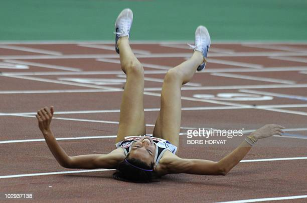 French Hind Dehiba Chahyd reacts after breaking the French record in the women's 1500 m event of the Paris IAAF Diamond League meeting on July 16,...