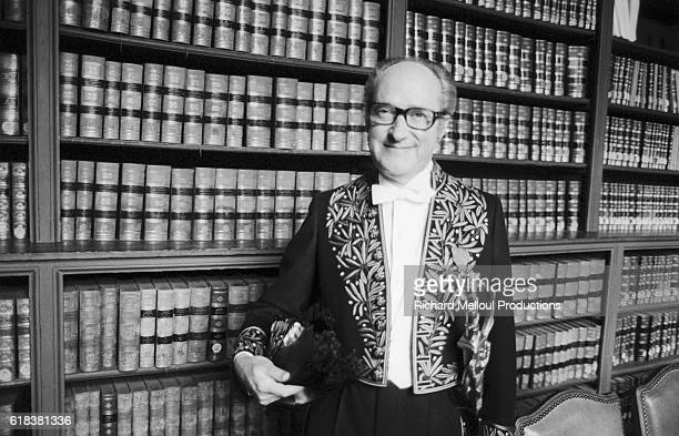 French historian Alain Decaux wears the official costume of the Academie Francaise as he stands next to bookshelves in Paris He was elected to the...