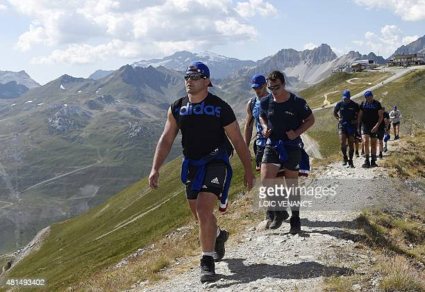 French hooker Benjamin Kayser walks with teammates to the Grande Motte glacier during their training camp in Tignes southeastern France on July 21...