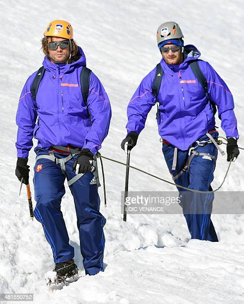 French hooker Dimitri Szarzewski and French lock Pascal Pape walk down the Grande Motte glacier during their training camp in Tignes southeastern...