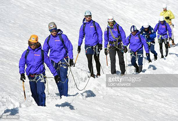 French hooker Dimitri Szarzewski and his teammates walk down the Grande Motte glacier during their training camp in Tignes southeastern France on...
