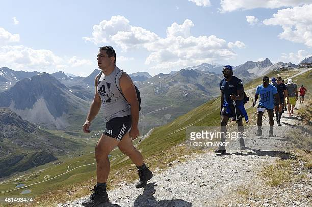 French hooker Guilhem Guirado walks with teammates to the Grande Motte glacier during their training camp in Tignes southeastern France on July 21...