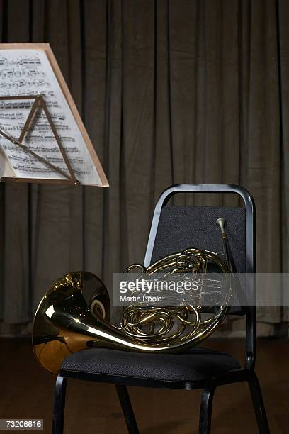 French horn on chair