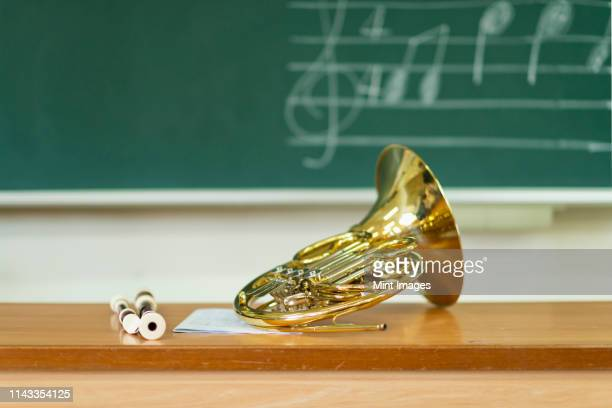 French horn sitting on desk in classroom
