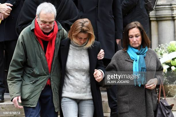 French horse rider Eugenie Angot leaves after she attended the funeral ceremony for her father French music composer Michel Legrand at the Saint...