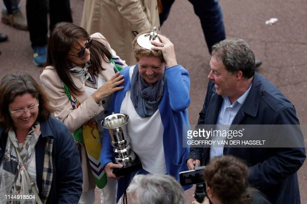 French horse trainer Isabelle Pacault celebrates after her trainee Carriacou won the the 141st edition of the Grand SteepleChase de Paris on May 19...