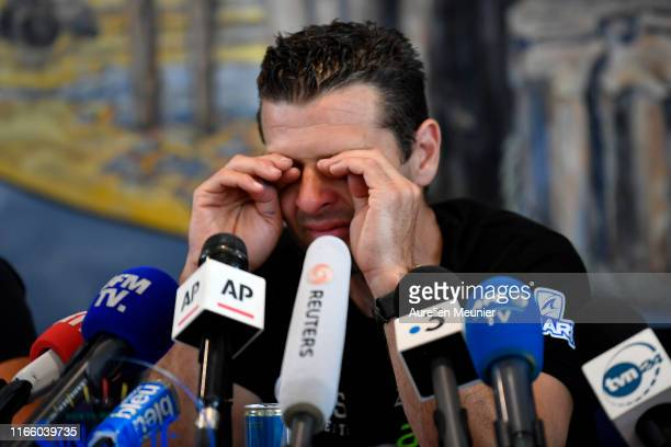 French hoverboard star Franky Zapata cries as he answers journalists during a press conference after he succeded to cross the Channel from France to...