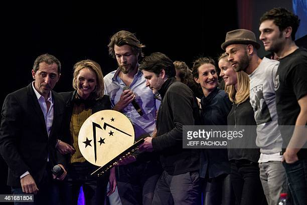 French humorist actor and president of the jury Gad Elmaleh poses with the cast of the film 'Toute premiere fois' directors Noemie Saglio and Maxime...