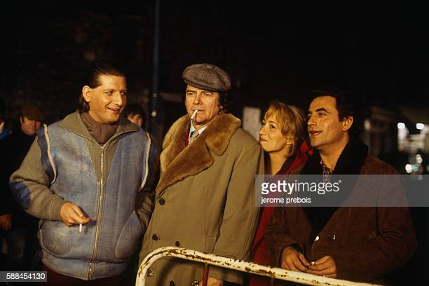 French humorist and actor Patrick Sebastien, director Jean-Pierre Mocky, actress Pauline Lafont and actor Richard Bohringer during the filming of...