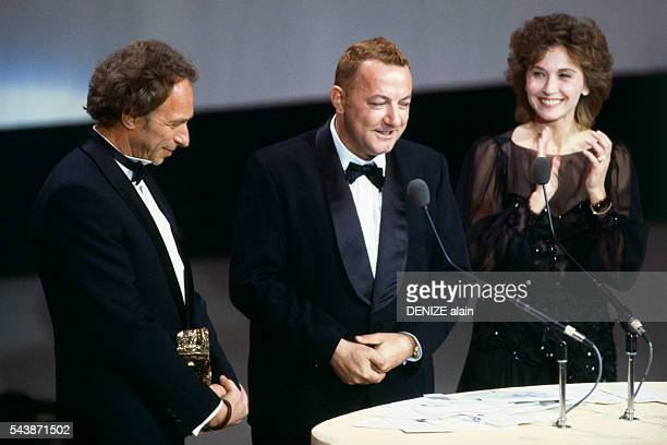 French humorist Coluche attends the 1984 César award ceremony to receive an award for Best Actor in the movie Tchao Pantin The award is presented by...