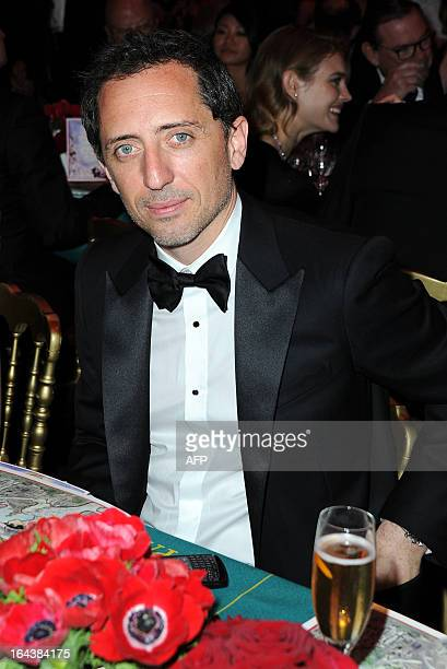 French humorist Gad Elmaleh poses as he attends the Bal de la Rose du Rocher at the MonteCarlo Sporting Club in Monaco on March 23 2013 The Rose Ball...