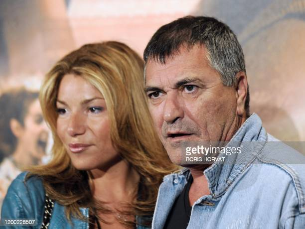 "French humorist Jean-Marie Bigard and his wife Claudia pose as they arrive for the premiere of the movie ""Ces amours-là"" by French director Claude..."