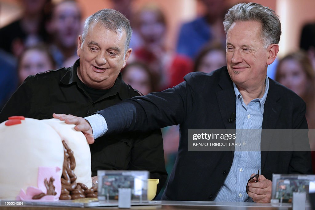 French humorist Jules Edouard Moustic and French humorist Benoit Delpine (R) take part in the TV show 'Le grand journal' on a set of French TV Canal+, on November 16, 2012 in Paris.