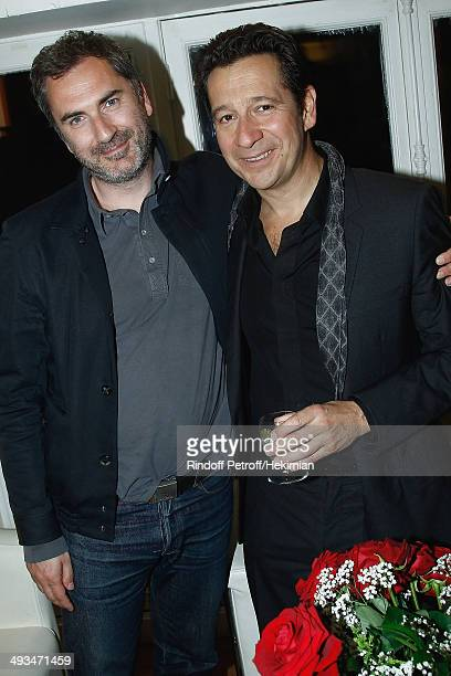 French humorist Laurent Gerra who celebrates his 25 years carreer and french director Xavier Giannoli are pictured after the Laurent Gerra show at...