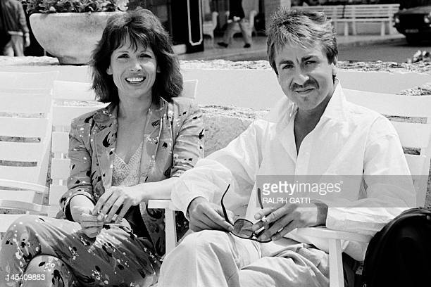 French humorists Chantal Lauby and Bruno Carette pose during the the 38th Cannes film festival on May 10, 1985. AFP PHOTO RALPH GATTI