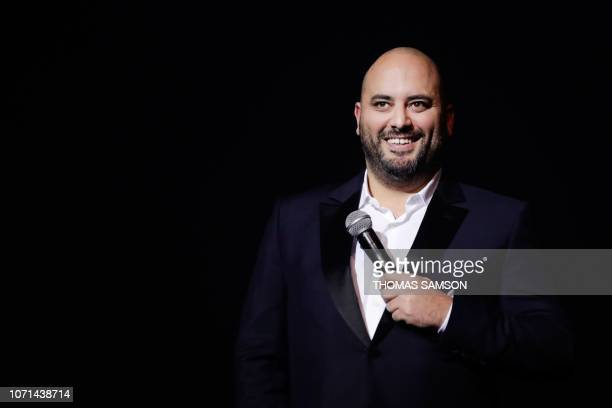 French humourist Jerome Commandeur celebrates after receiving the 'Best Humorist' award during the SACEM Grand Prix awards ceremony on December 10...