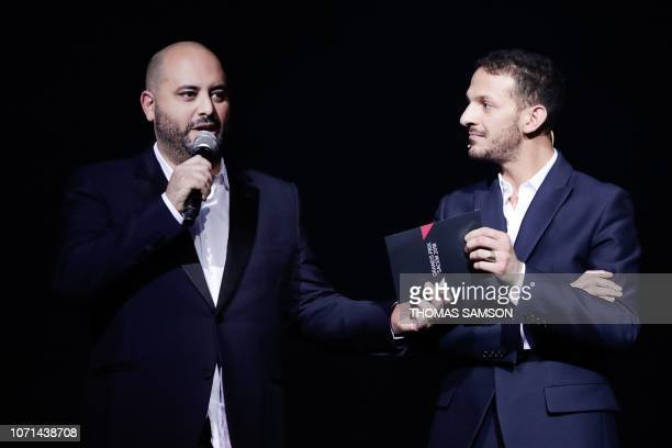 French humourist Jerome Commandeur celebrates with French humorist and host Vincent Dedienne after receiving the 'Best Humorist' award during the...