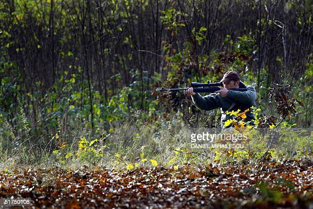 French hunter takes aim in an organized hunt in a forest near Oradea city 11 November 2004 Over 2000 hunting tourists mainly from western Europe...