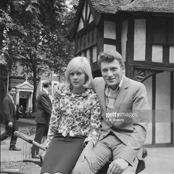 French husband and wife singers Sylvie Vartan and Johnny Hallyday posed together in Soho Square, London on 27th June 1965.