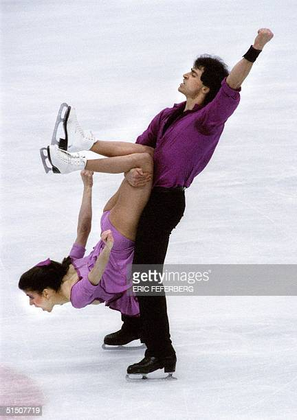 French ice dancer Paul Duchesnay punches his fist in the air as he holds his sister Isabelle at the end of their free program at the Winter Olympic...