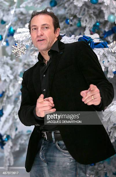 French ice skater Philippe Candeloro poses on December 17 2013 in Paris during the presentation of the French TV France Televisions' staff members...