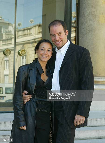 French ice skating couple Sarah Abitbol and Stephane Bernadis pose in the Courtyard of the Elysee Palace April 7 2003 in Paris Jacques Chirac...