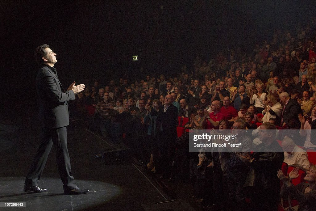 French impersonator Laurent Gerra (L) acknowledges applause at the end of his One Man Show at Palais des Congres on November 30, 2012 in Paris, France.