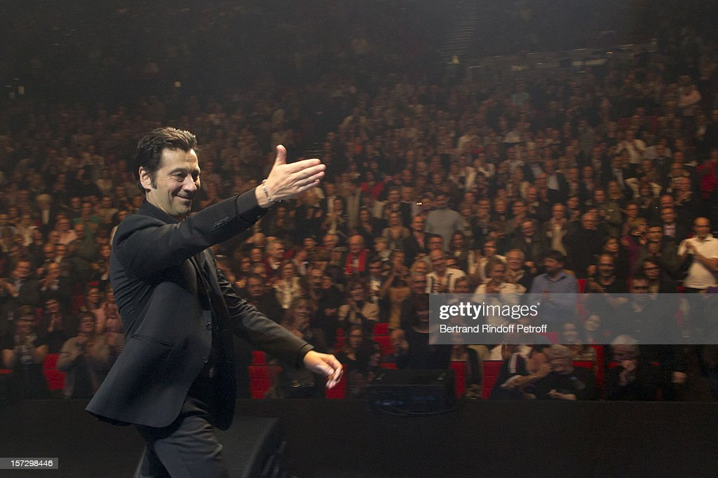 French impersonator Laurent Gerra acknowledges applause at the end of his One Man Show at Palais des Congres on November 30, 2012 in Paris, France.