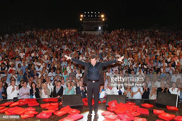 French impersonator Laurent Gerra during the traditional throw of cushions at the final of his show at the 30th Ramatuelle Festival Day 4 on August 4...
