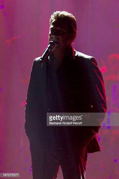 French impersonator Laurent Gerra imitates singer Jean Ferrat during his One Man Show at Palais des Congres on November 29 2012 in Paris France