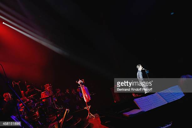 French impersonator Laurent Gerra imitates singer Jean Ferrat performing in his show 'Un spectacle Normal' at L'Olympia on December 19 2013 in Paris...